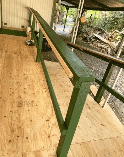 Accessibility ramp with painted handrail