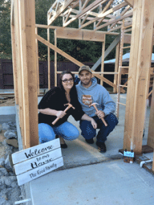 Johnathan and Kindra in their framed home