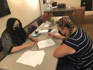 Alicia signing closing escrow documents