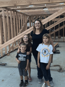 Alicia's family in their framed home